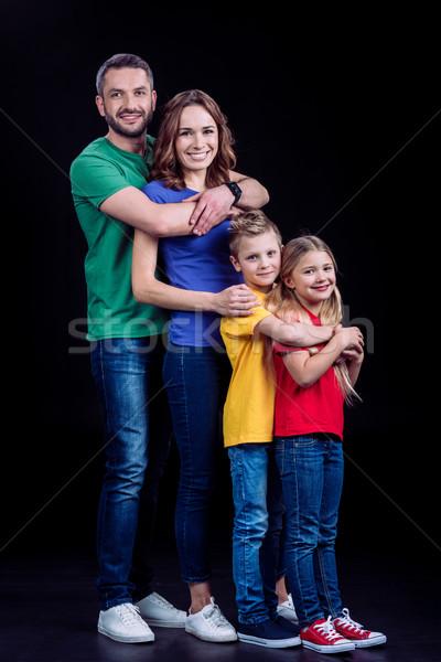 Family smiling at camera  Stock photo © LightFieldStudios