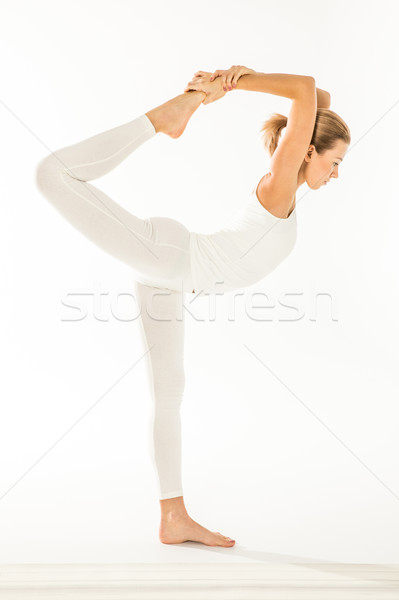 Woman standing in yoga pose  Stock photo © LightFieldStudios
