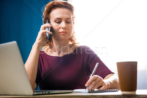 Woman talking on smartphone Stock photo © LightFieldStudios