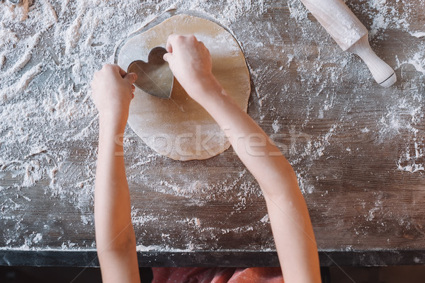 'Close-up partial view of child preparing cookies, Mothers day concept Stock photo © LightFieldStudios