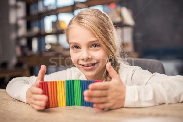 Meisje spelen cute kleurrijk glimlachend camera Stockfoto © LightFieldStudios