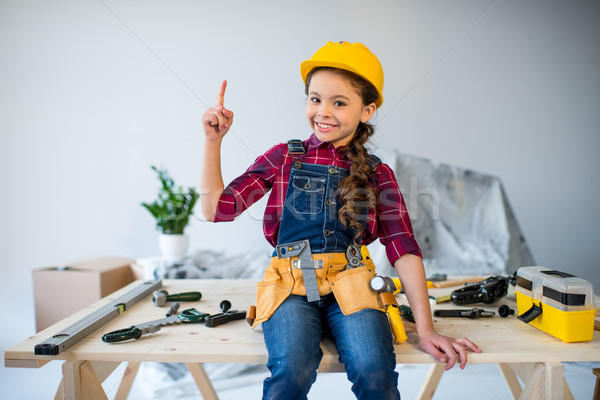 Little girl in tool belt Stock photo © LightFieldStudios