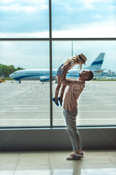father and kid in airport Stock photo © LightFieldStudios