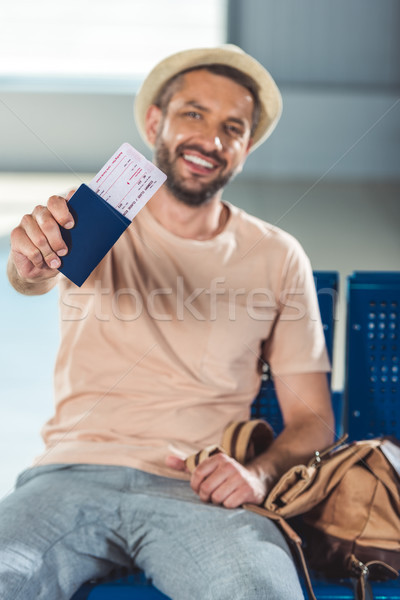tourist showing passport and ticket Stock photo © LightFieldStudios