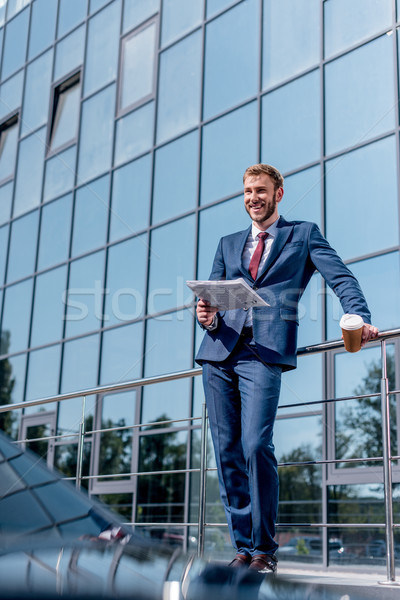 Stock photo: businessman at office building