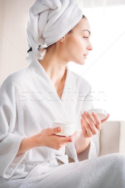 Stock photo: woman holding jar of cream