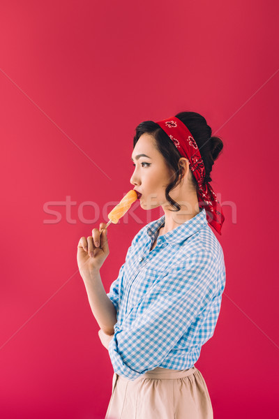 asian woman with popsicle  Stock photo © LightFieldStudios