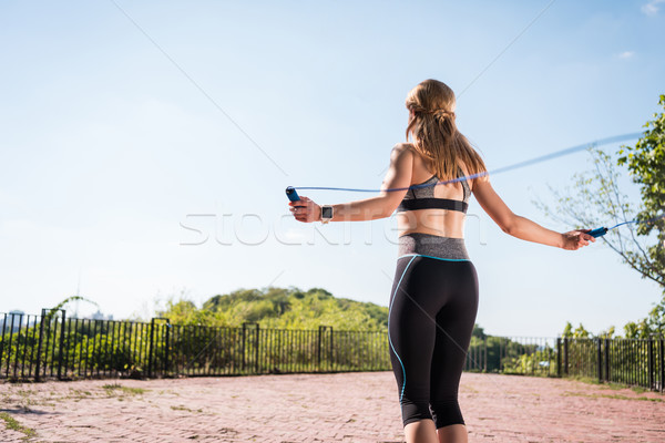 sportswoman jumping on skipping rope Stock photo © LightFieldStudios