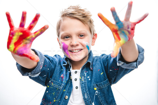 Excited schoolboy artist  Stock photo © LightFieldStudios