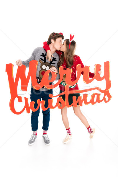 Stock photo: couple with merry christmas lettering