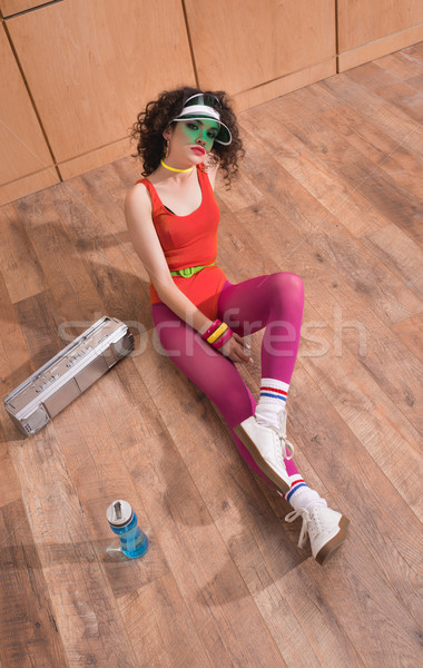 Stock photo: fashionable woman in body suit and cap