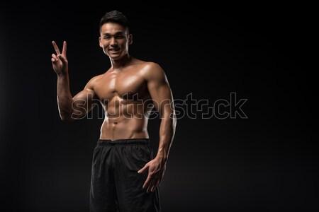 sportsman showing thumb up  Stock photo © LightFieldStudios