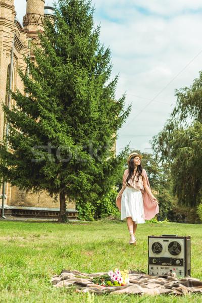 stylish girl in straw hat at park Stock photo © LightFieldStudios