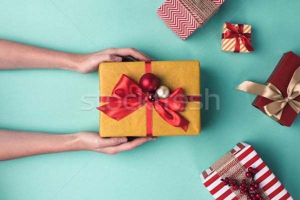hands holding christmas gift box Stock photo © LightFieldStudios