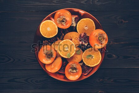 top view of persimmons in rows on black Stock photo © LightFieldStudios