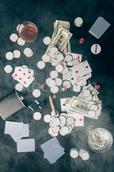 Smoke over chips and money on casino table Stock photo © LightFieldStudios