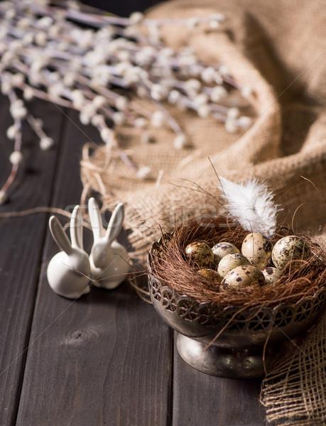 Easter bunnies and quail eggs Stock photo © LightFieldStudios