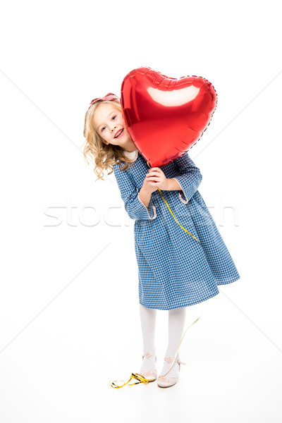 Stock photo: Girl with heart shaped balloon