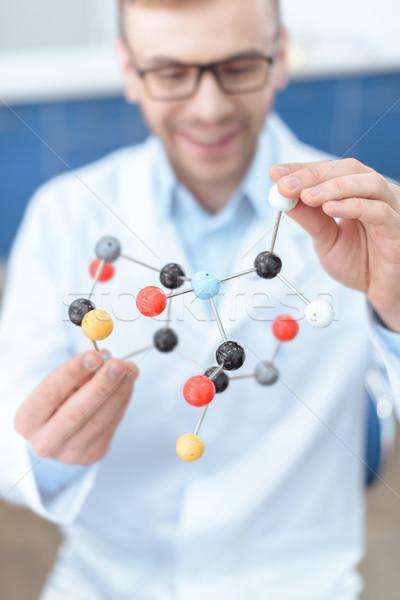 Sonriendo hombre científico bata de laboratorio molecular Foto stock © LightFieldStudios