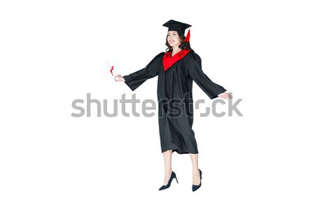 attractive student in graduation cap with diploma jumping isolated on white Stock photo © LightFieldStudios