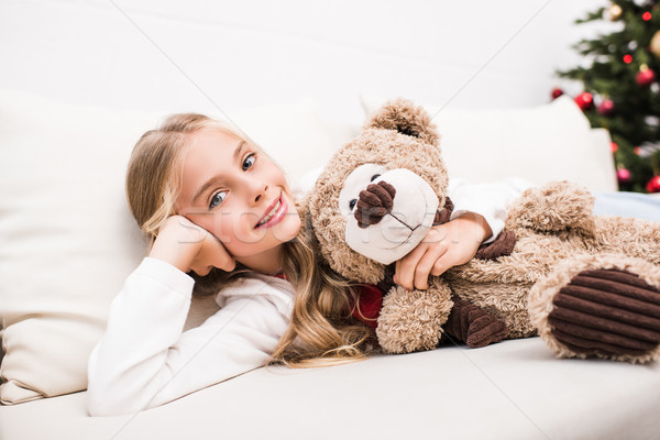 Enfant Nounours adorable petite fille canapé Photo stock © LightFieldStudios
