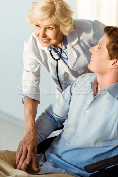 医師 笑みを浮かべて 若い男 車いす 座って 立って ストックフォト © LightFieldStudios