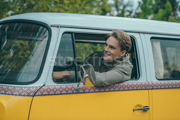 Férfi vezetés retro mikrobusz jóképű mosolyog Stock fotó © LightFieldStudios