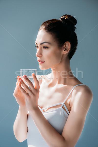 Fiatal nő tart üveg víz gyönyörű természetes Stock fotó © LightFieldStudios