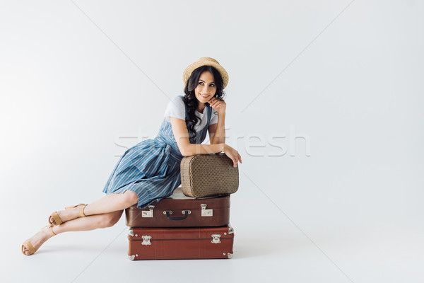 smiling woman with luggage Stock photo © LightFieldStudios