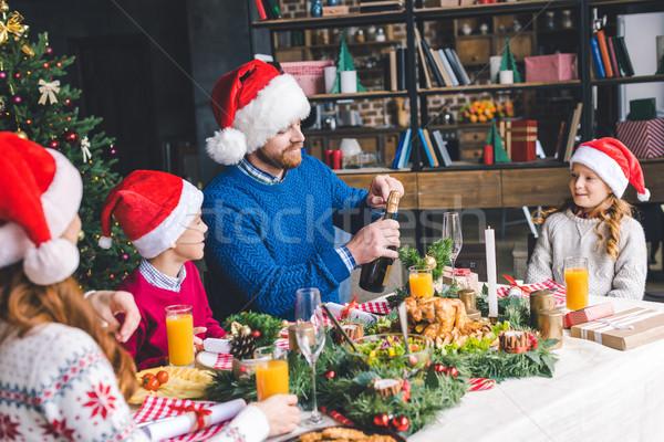 Familie christmas diner jonge gelukkig gezin liefde Stockfoto © LightFieldStudios