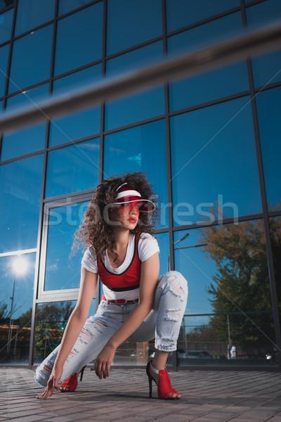 Fiatal divatos nő piros sapka farmer Stock fotó © LightFieldStudios