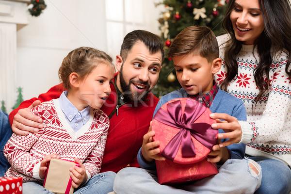 family with christmas presents Stock photo © LightFieldStudios