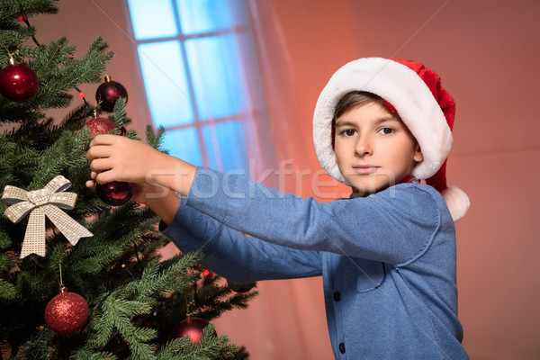 boy decorating christmas tree Stock photo © LightFieldStudios