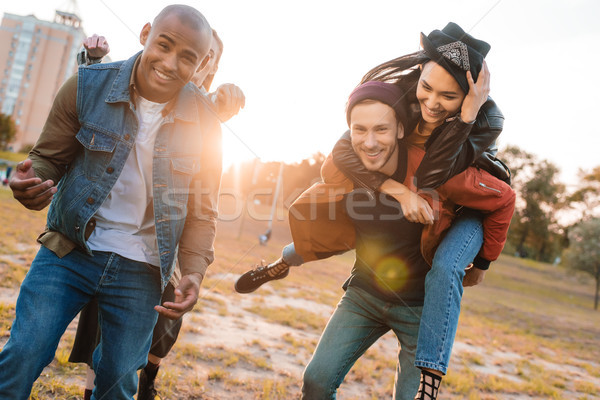 smiling multicultural friends in park Stock photo © LightFieldStudios