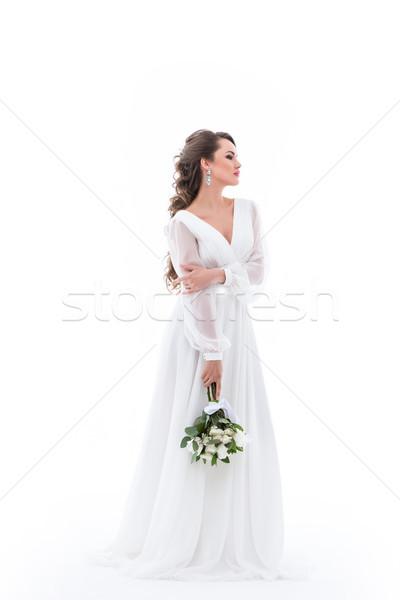 Elegant mireasă prezinta rochie de culoare alba izolat Imagine de stoc © LightFieldStudios