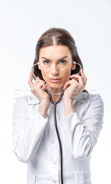 Női orvos sztetoszkóp koncentrált háziorvos tart Stock fotó © LightFieldStudios