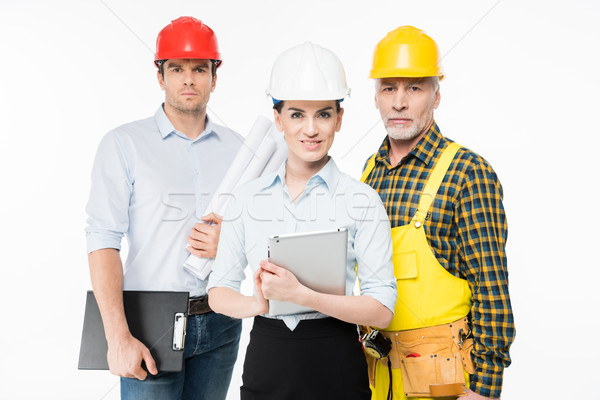 Stock photo: Two architects and workman