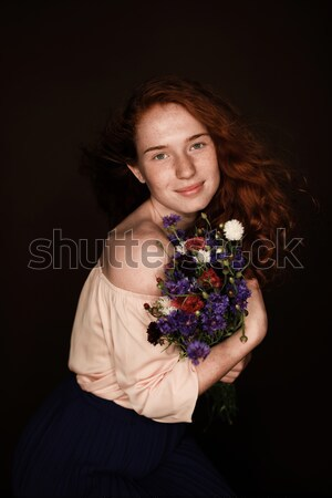 Beautiful young woman in dress holding pink tulips and smiling at camera, international womens day c Stock photo © LightFieldStudios