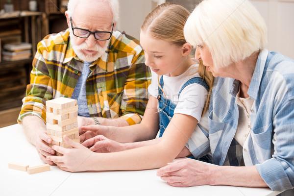 концентрированный девочку дедушка и бабушка играет игры вместе Сток-фото © LightFieldStudios