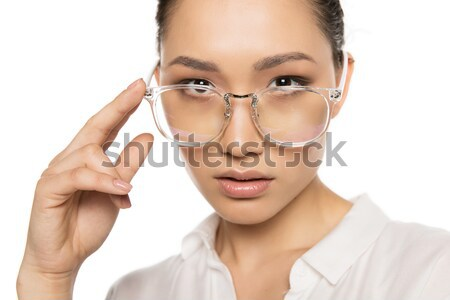 woman with magnifying glass Stock photo © LightFieldStudios
