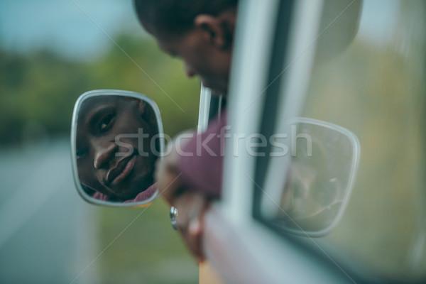 Férfi néz tükör mikrobusz jóképű fiatal Stock fotó © LightFieldStudios