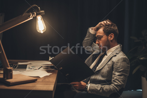 overworked businessman with paperwork  Stock photo © LightFieldStudios