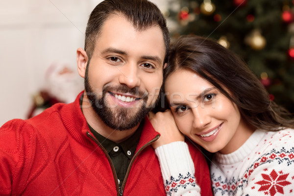 happy couple at christmastime Stock photo © LightFieldStudios