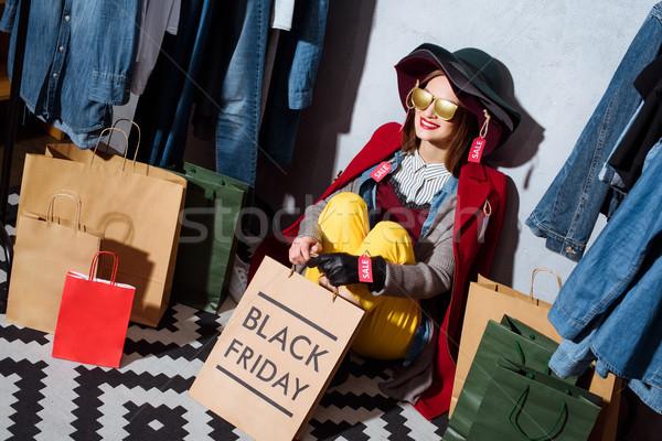 Black friday kadın şapka farklı elbise satış Stok fotoğraf © LightFieldStudios