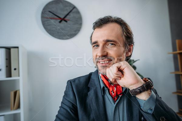 Przystojny w średnim wieku biznesmen elegancki uśmiechnięty kamery Zdjęcia stock © LightFieldStudios