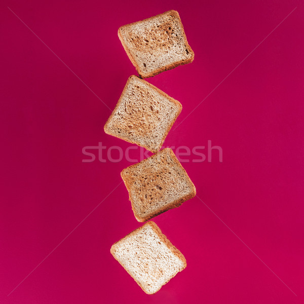 close up view of levitating toasts isolated on pink Stock photo © LightFieldStudios