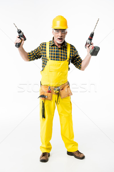 Stock photo: Workman holding electric drills