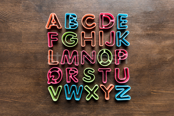 top view of baking forms for cookies in forms of letters on tabletop, baking cookies Stock photo © LightFieldStudios