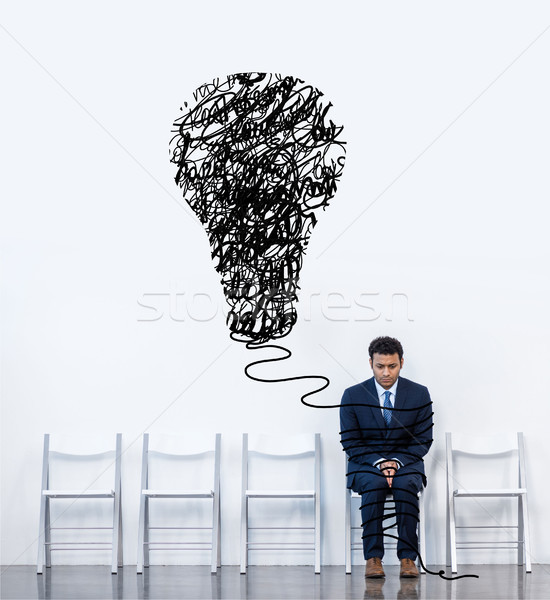 businessman sitting on chair Stock photo © LightFieldStudios