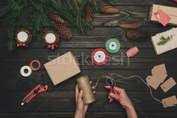 woman decorating christmas gift Stock photo © LightFieldStudios